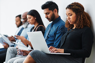Buy stock photo Studio shot of a group of diverse businesspeople waiting in line