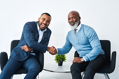 Buy stock photo Shot of two businessmen shaking hands in  modern office