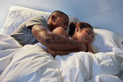 Buy stock photo Cropped shot of an affectionate young couple sleeping in bed at home