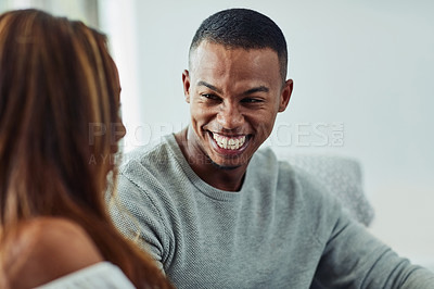 Buy stock photo Cropped shot of a young couple talking on the sofa at home