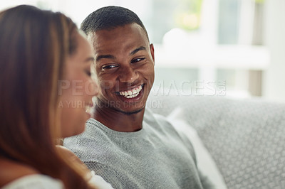 Buy stock photo Cropped shot of a young attractive couple chilling on the sofa at home
