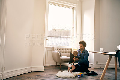 Buy stock photo Full length shot of a handsome father and his baby boy spending time together at home