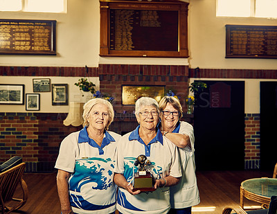 Buy stock photo Portrait of three senior woman holding a trophy in the clubhouse with after their game of bowls