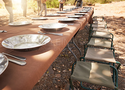 Buy stock photo Shot of a nicely set table awaiting guests for lunch at a holiday resort outside during the day