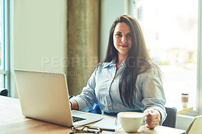 Buy stock photo Portrait of a young woman using a laptop in a cafe