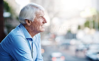 Buy stock photo Cropped shot of a senior businessman outside the office looking at the city