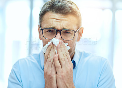 Buy stock photo Cropped portrait of a handsome mature businessman blowing his nose