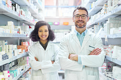 Buy stock photo Portrait of a confident mature man and young woman working together in a pharmacy