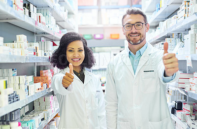 Buy stock photo Portrait of a confident mature man and young woman showing thumbs up in a pharmacy