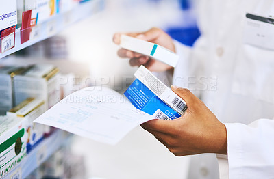 Buy stock photo Cropped shot of a pharmacist filling a prescription