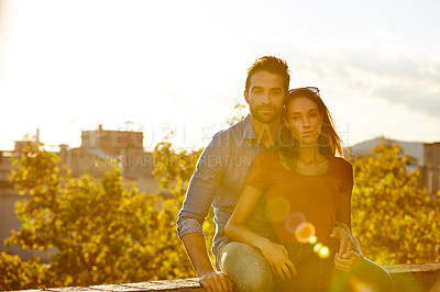 Buy stock photo Shot of a couple out on a rooftop for their date