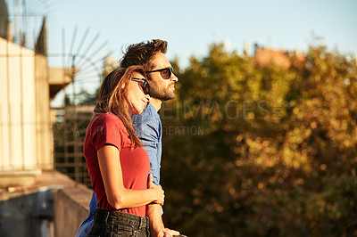 Buy stock photo Shot of an affectionate young couple exploring a foreign city