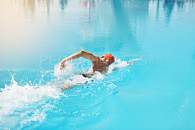Buy stock photo High angle shot of a handsome young male swimmer swimming in a pool