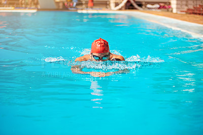 Buy stock photo Shot of an unrecognizable young male swimmer doing breaststroke in a swimming pool