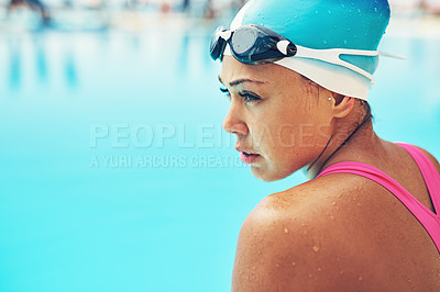 Buy stock photo High angle shot of an attractive young female swimmer sitting on the side of the pool