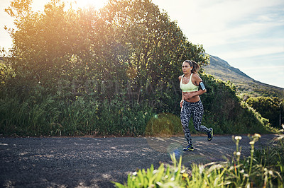 Buy stock photo Full length shot of an attractive young female athlete out for a morning run