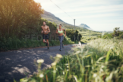 Buy stock photo Full length shot of a young couple out for their morning run