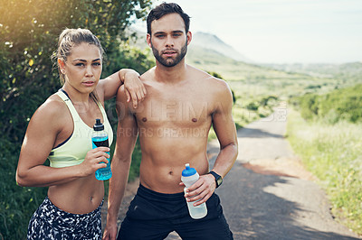 Buy stock photo Cropped portrait of an affectionate young couple taking fluids on board while out for their morning run