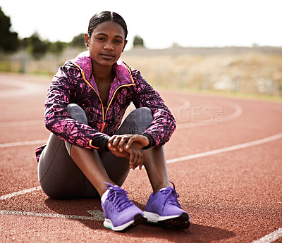 Buy stock photo Shot of a young athlete out on the track