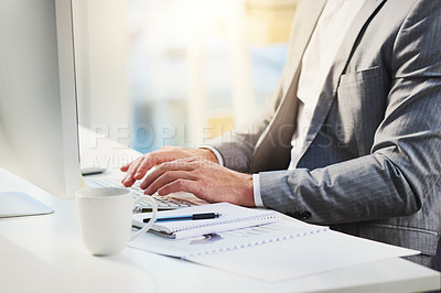 Buy stock photo Closeup shot of an unrecognizable businessman working on a computer in an office