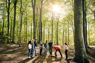 Buy stock photo Full length shot of a group of diverse colleagues team building at a company retreat
