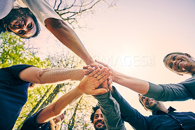 Buy stock photo Low angle shot of a group of diverse colleagues team building at a company retreat