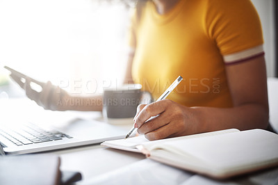 Buy stock photo Closeup shot of an unrecognizable female designer using a cellphone and writing notes in her home office