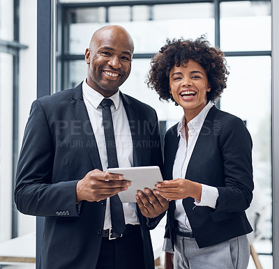 Buy stock photo Shot of a young businesswoman and mature businessman using a digital tablet together in a modern office