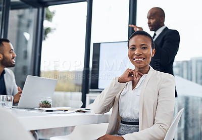 Buy stock photo Portrait of a confident mature businesswoman having a meeting with colleagues in the boardroom of a modern office