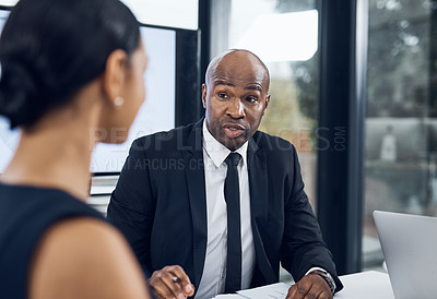 Buy stock photo Shot of a businessman and businesswoman having a meeting in the boardroom of a modern office