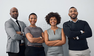 Buy stock photo Studio portrait of a group of businesspeople standing together against a gray background