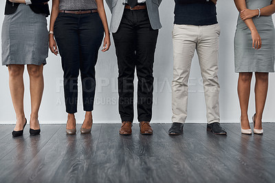 Buy stock photo Closeup shot of a group of unrecognizable businesspeople standing in line