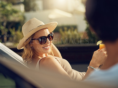 Buy stock photo Cropped shot of an attractive mature woman drinking juice while relaxing outside with her husband