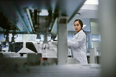 Buy stock photo Shot of a young woman using a computer while working in a laboratory