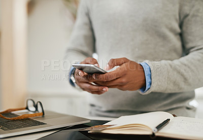 Buy stock photo Closeup shot of an unrecognizable man using a cellphone at home