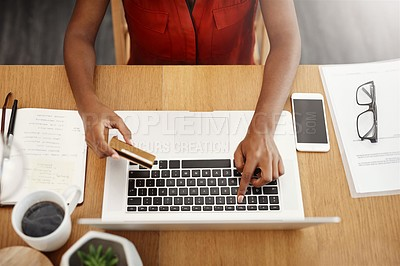 Buy stock photo Cropped shot of an unrecognizable businesswoman shopping online in her home office