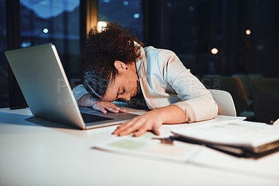 Buy stock photo Cropped shot of a young attractive businesswoman sleeping on her desk while on a late shift in the office