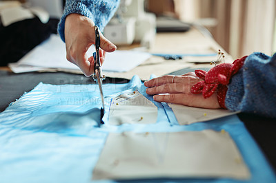 Buy stock photo Shot of a young designer cutting out patterns for her design
