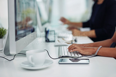 Buy stock photo Closeup shot of unrecognizable call centre agents working in an office