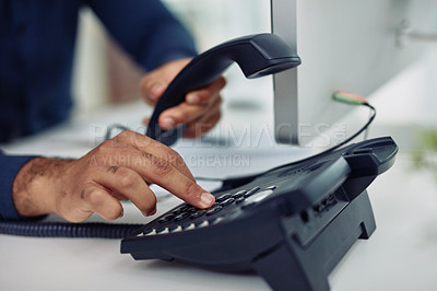 Buy stock photo Closeup shot of unrecognizable businessman using a telephone in an office