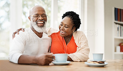 Buy stock photo Shot of a mature couple enjoying a relaxing coffee break at home
