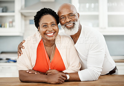 Buy stock photo Shot of a happy mature couple spending a relaxing day at home
