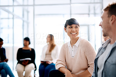 Buy stock photo Shot of a young man and woman having a conversation during a business conference