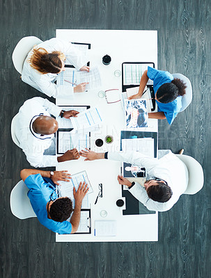Buy stock photo High angle shot of a medical team having a meeting in the hospital boardroom