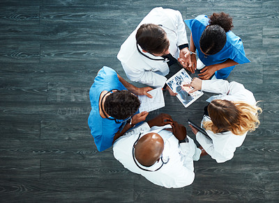 Buy stock photo High angle shot of a medical team having a meeting in the hospital