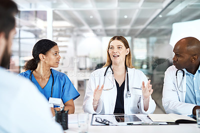 Buy stock photo Cropped shot of a medical team having a meeting in the hospital boardroom