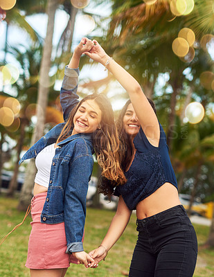 Buy stock photo Cropped shot of two female best friends being playful in a public park
