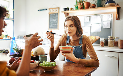 Buy stock photo Cropped shot of a woman having breakfast at home