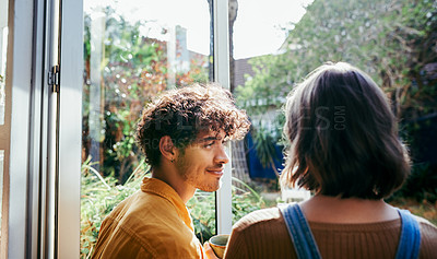 Buy stock photo Rearview shot of a young couple siting in the doorway of their home