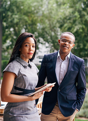 Buy stock photo Portrait of a confident young businesswoman and businessman standing together outdoors